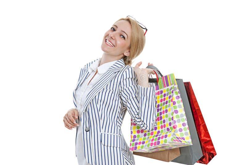 påsar som shoppar kvinnabarn arkivbild