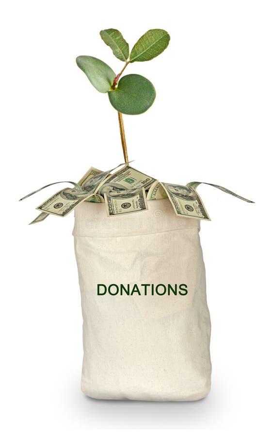 Påse av donationer arkivfoto