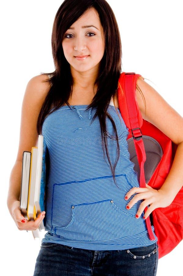 påsen books att posera för högskolaflicka royaltyfria foton