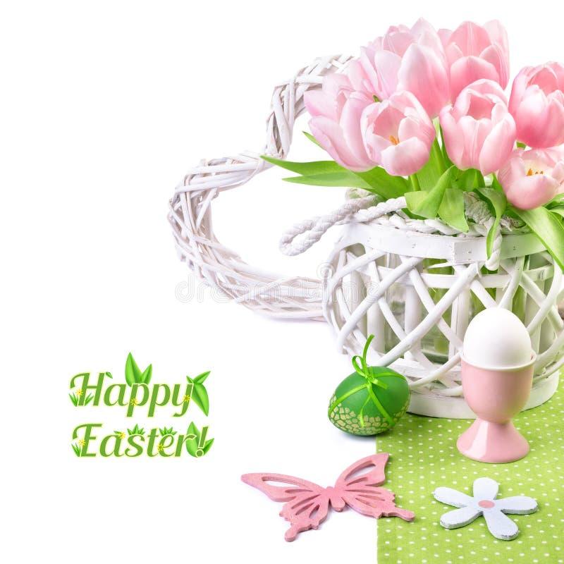 Påskgräns med rosa tulpan och att matcha vårgarneringar arkivfoto