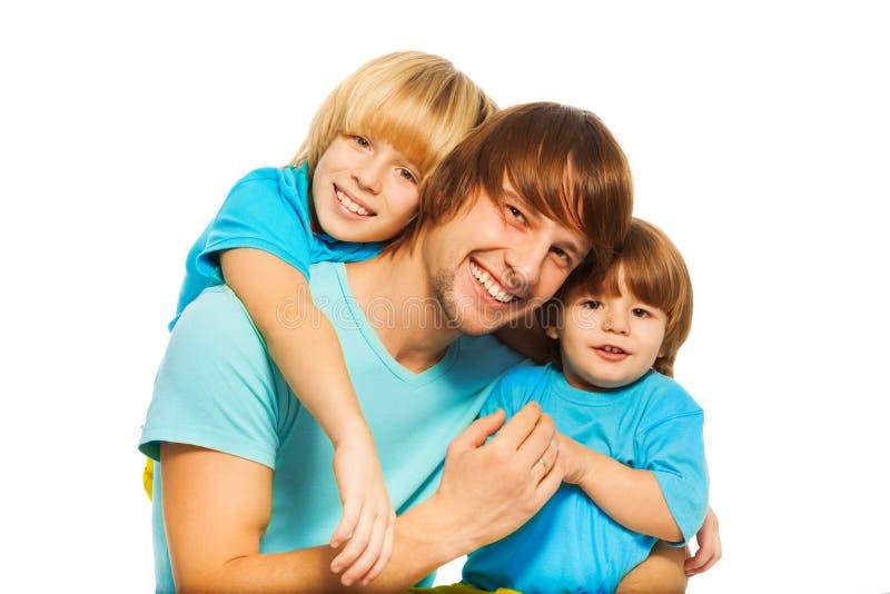Père avec des fils image libre de droits