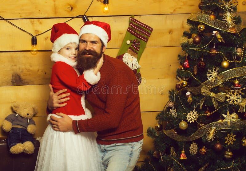 Père et fille barbus de Noël photographie stock libre de droits