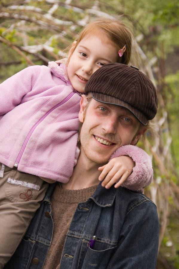 Père heureux et petit descendant photographie stock