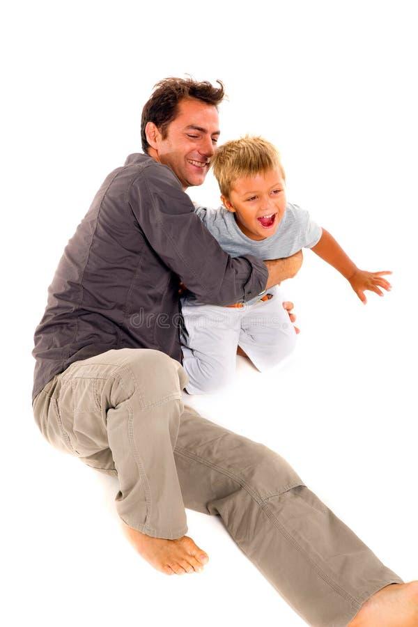 Père jouant avec son fils images libres de droits