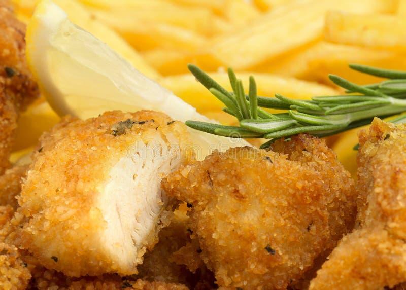 pépite de poulet avec le romarin images stock