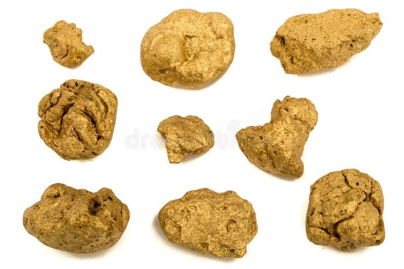 Pépites d'or, d'isolement sur le fond blanc images stock