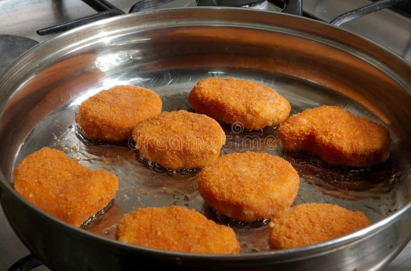 Pépites de poulet images stock