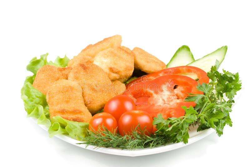 Pépites de poulet avec des légumes photos libres de droits