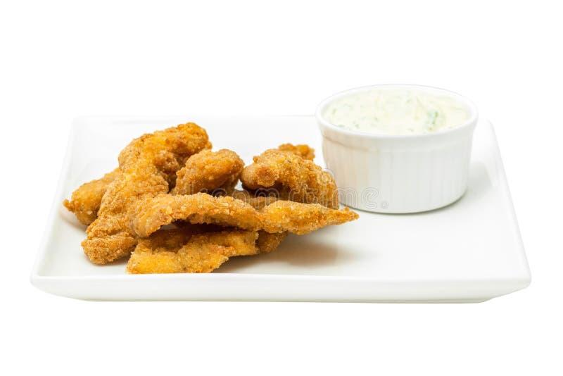 Pépites de poulet avec de la sauce à mayonnaise image stock