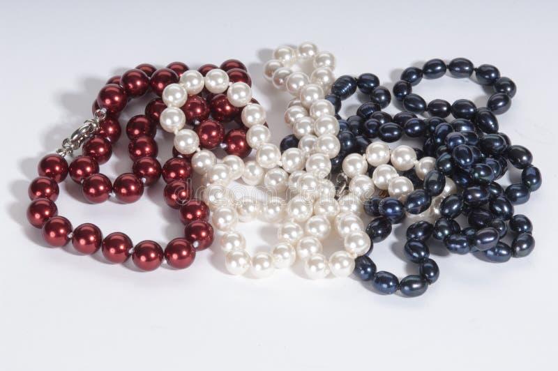 Pérolas vermelhas, brancas, e azuis foto de stock royalty free