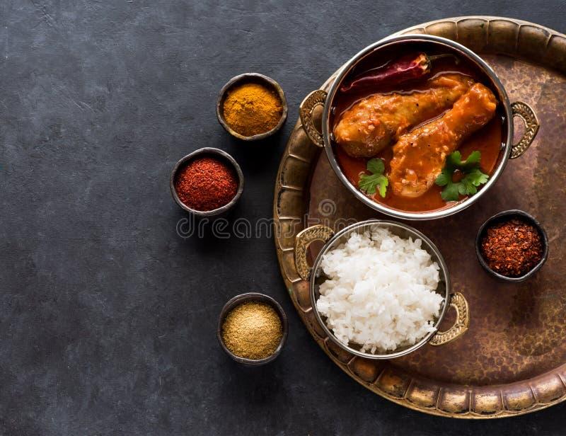 Pés de galinha picantes com arroz Prato indiano fotos de stock