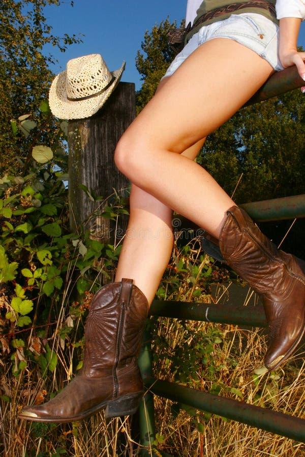 Pés do Cowgirl fotografia de stock