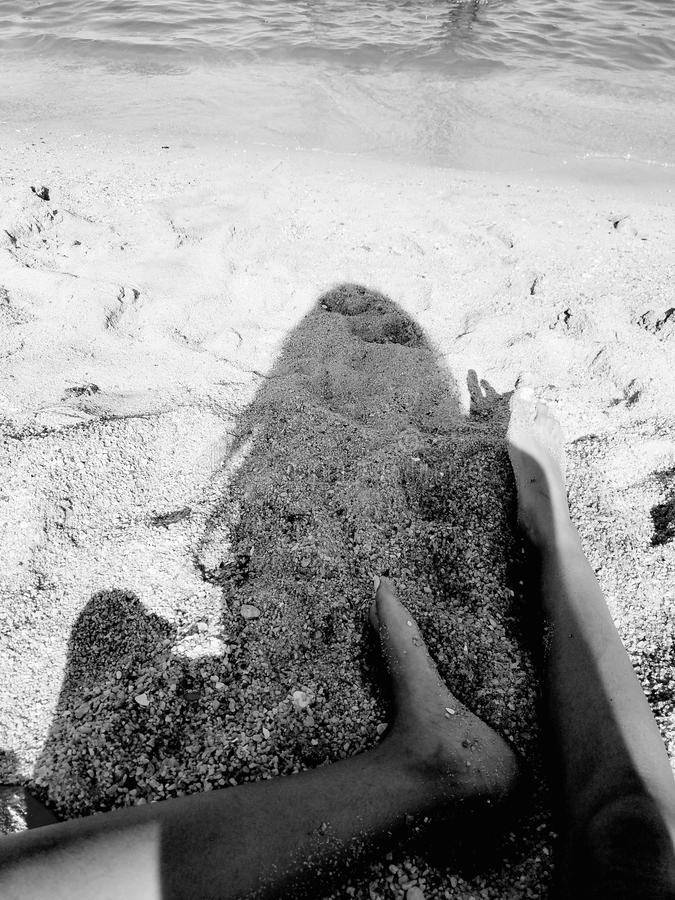 Pés na areia imagens de stock royalty free