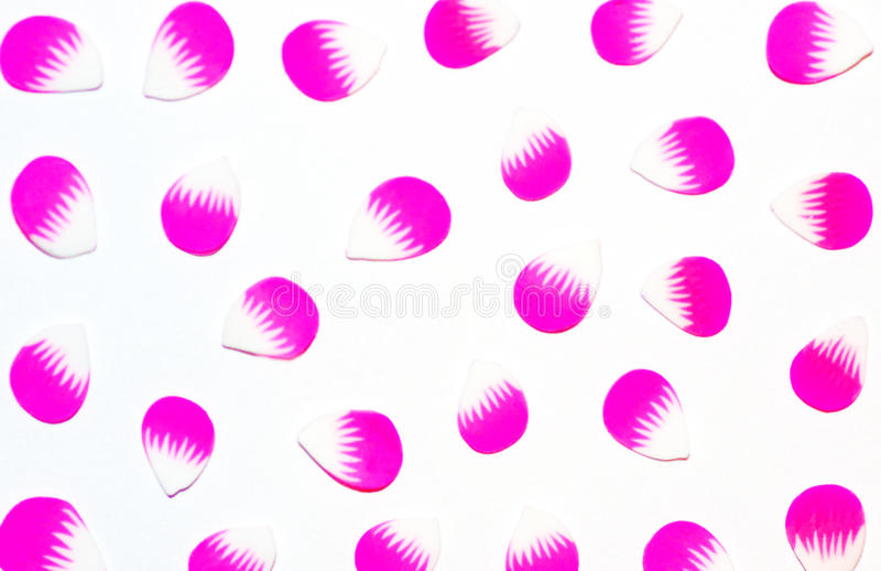 Pétalas isoladas pequenas de flores cor-de-rosa imagens de stock