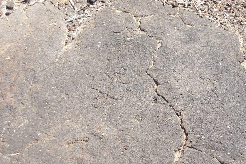 Pétroglyphes, découpages de roche images libres de droits