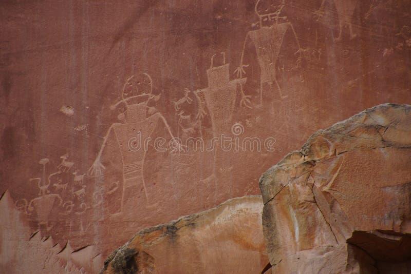 Pétroglyphes des personnes de Natif américain d'Anasazi photo libre de droits