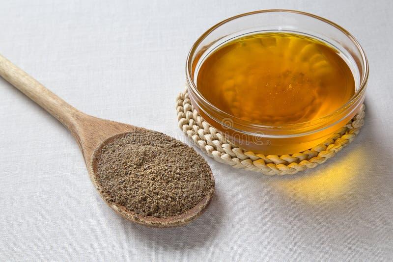 Pétrole de semence d'oeillette et graines de lin photo libre de droits
