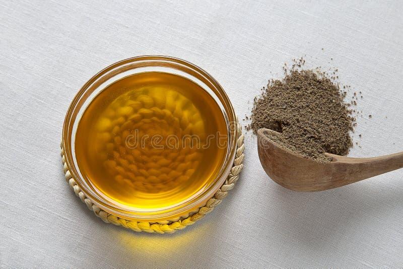 Pétrole de semence d'oeillette et graines de lin images stock