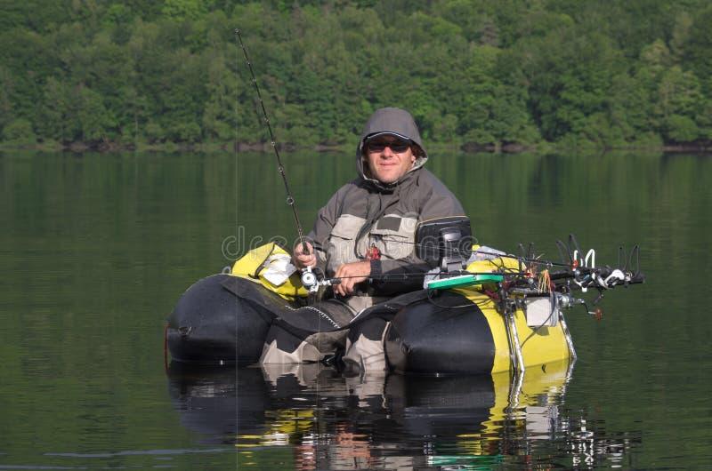Pêche avec un tube de flotteur images libres de droits
