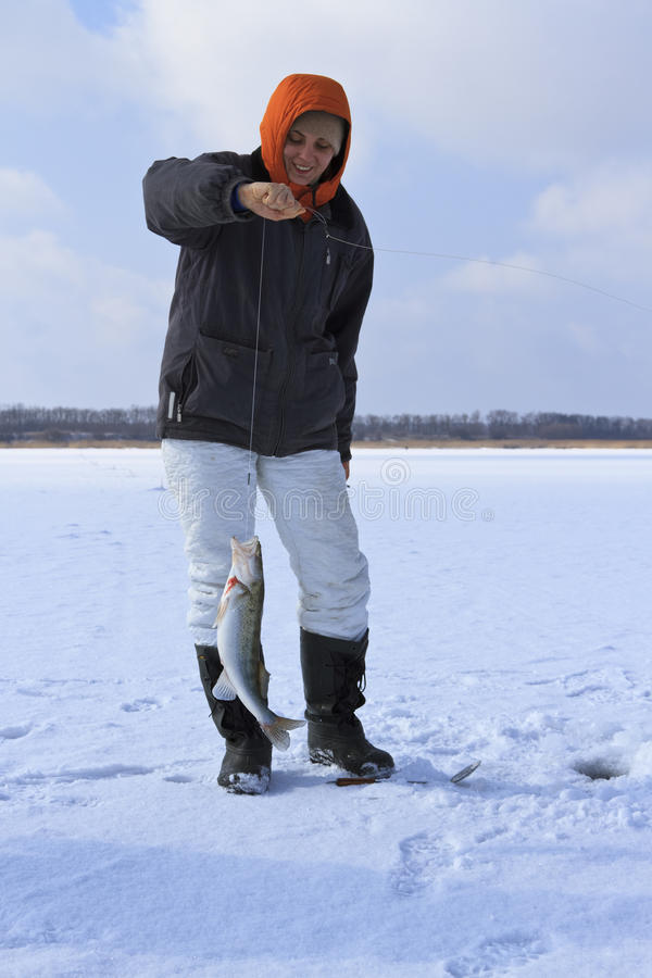 Pêche de glace. photo stock