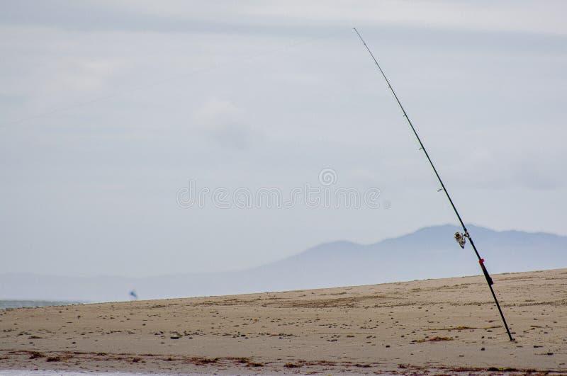 La Canne à Pêche A Collé Dans Le Sable, Sur La Plage De