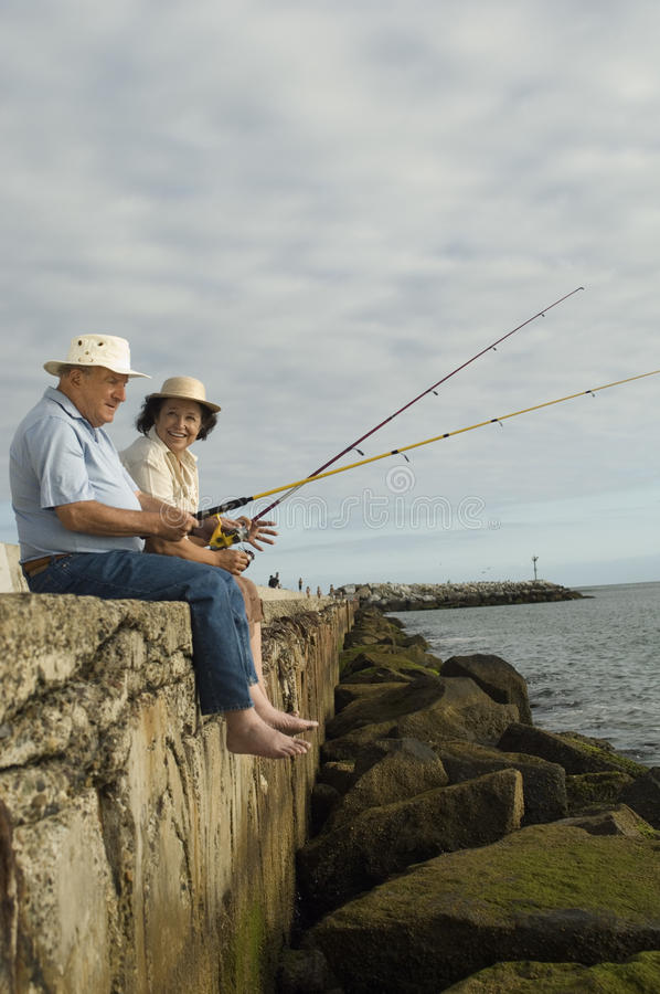 Pêche supérieure de couples photographie stock libre de droits