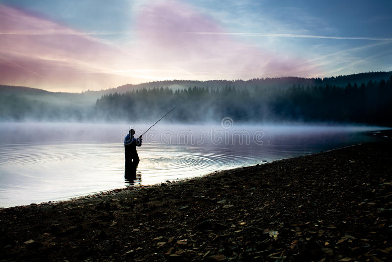 Pêche tôt le matin photo libre de droits