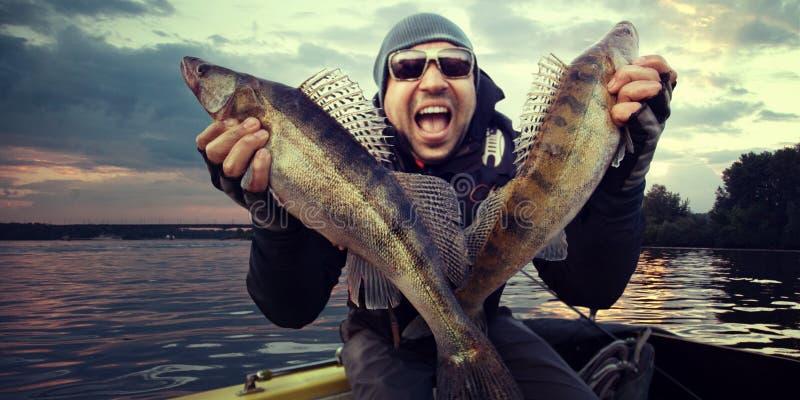 Pêcheur à la ligne heureux photographie stock