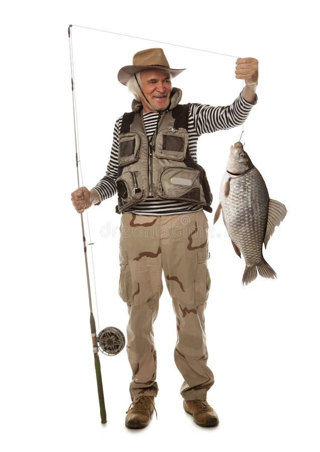 Pêcheur avec de grands poissons Gibelio d'auratus de Carassius de carpe de Crucian images stock