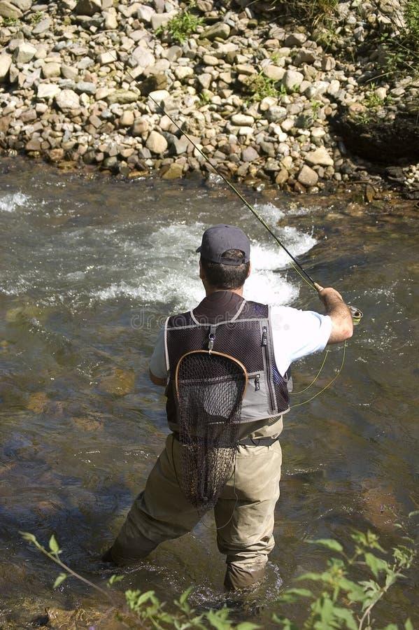 Pêcheur dans un fleuve photos stock