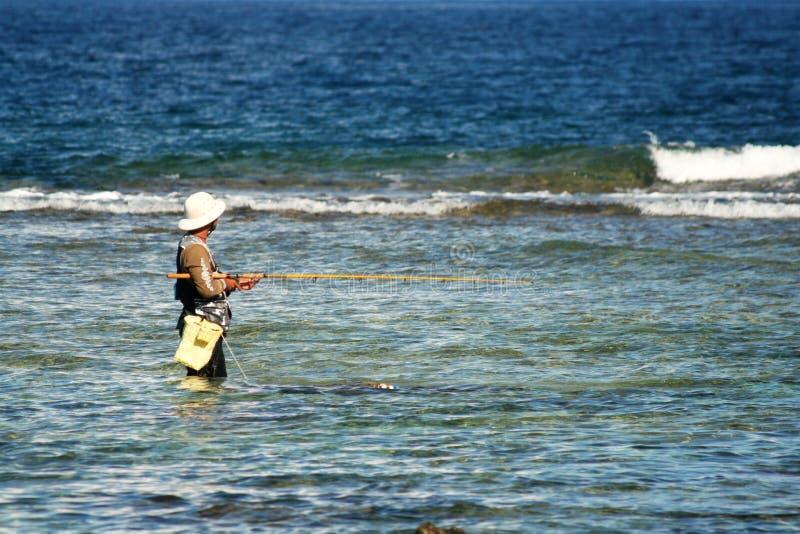 Download Pêcheur de la Guam photo stock. Image du guam, heat, onde - 2142884