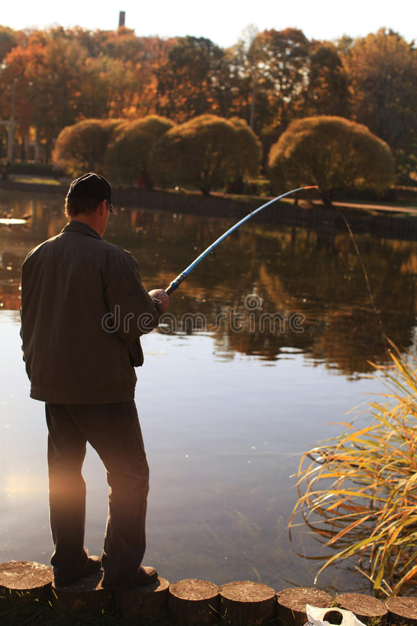 Pêcheur en soleil image libre de droits