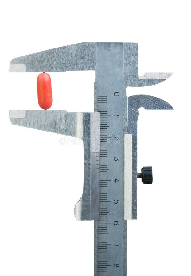 Píldora de la medida del calibrador imagen de archivo