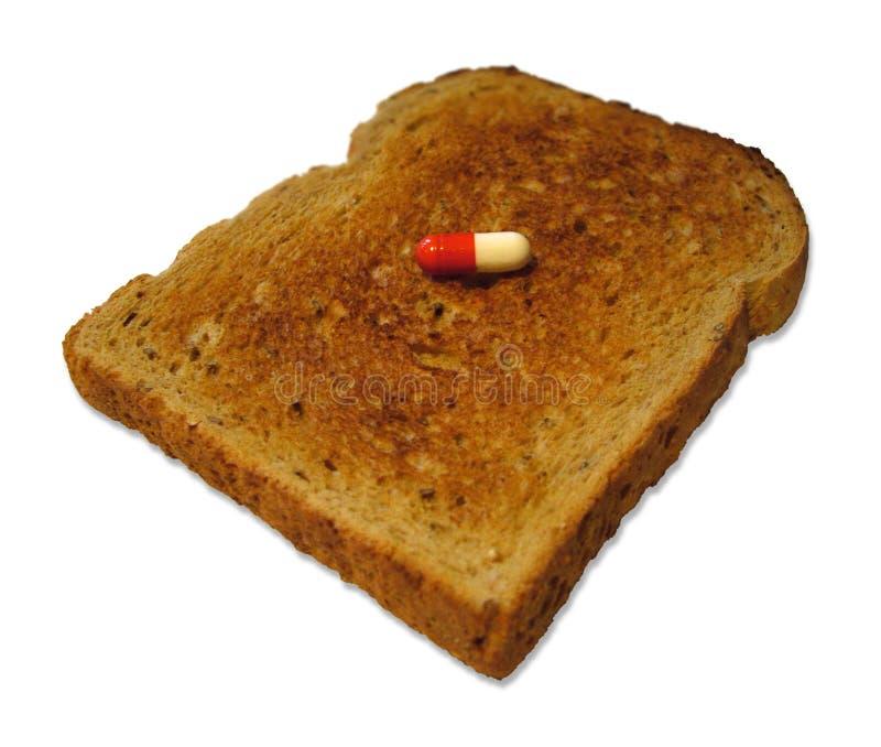 Píldora en tostada foto de archivo libre de regalías