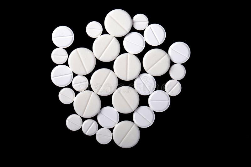 Píldoras blancas de la medicina imagen de archivo