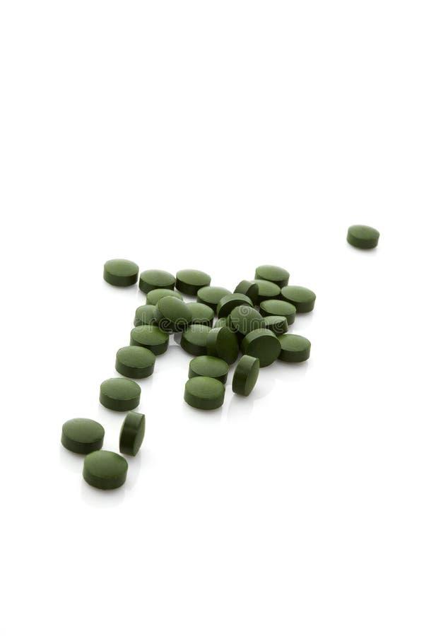 Píldoras de la Chlorella. fotografía de archivo