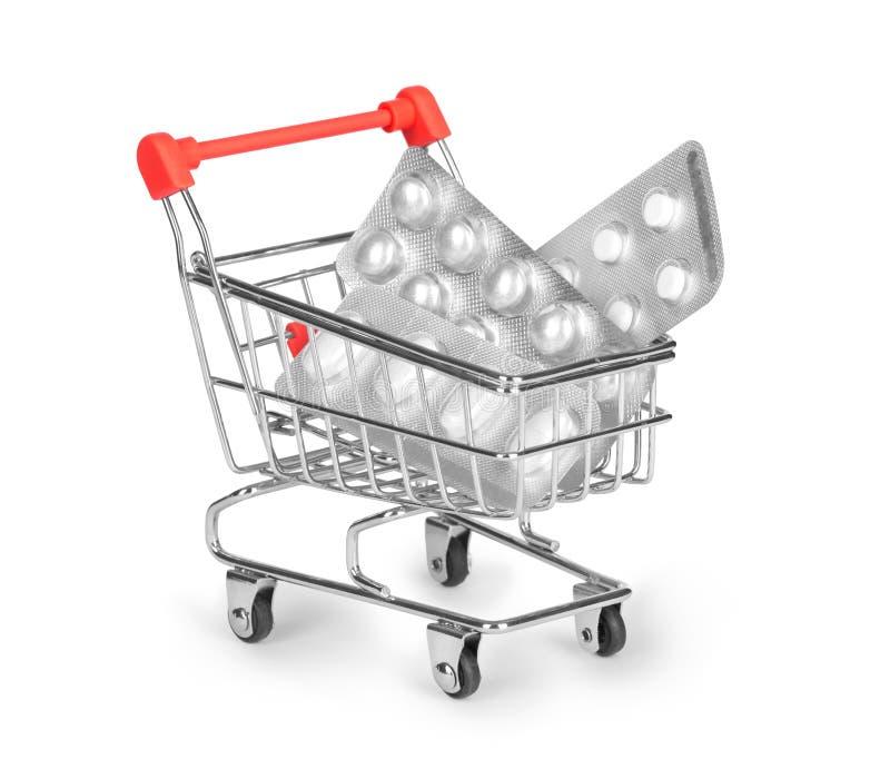 píldoras del carro de la compra aisladas en blanco fotografía de archivo libre de regalías