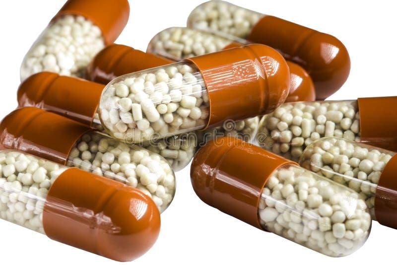 Píldoras digestivas aisladas en el fondo blanco fotografía de archivo
