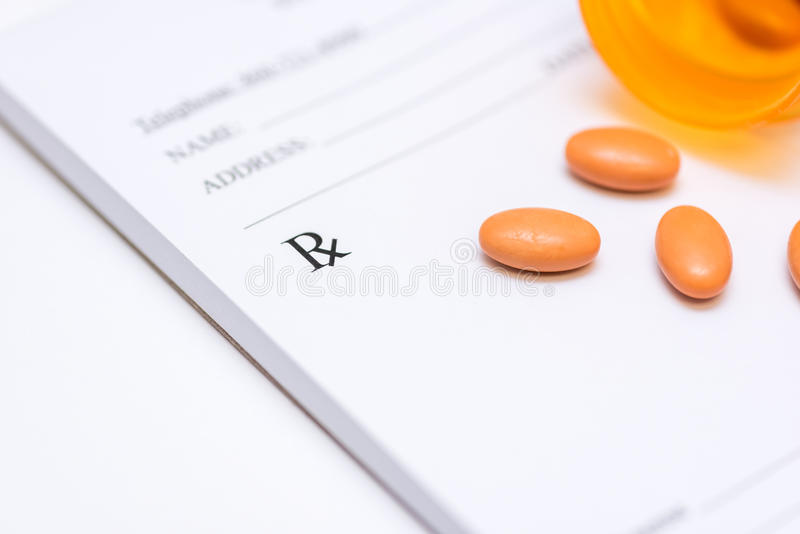 Píldoras en un cojín de la prescripción imagen de archivo libre de regalías