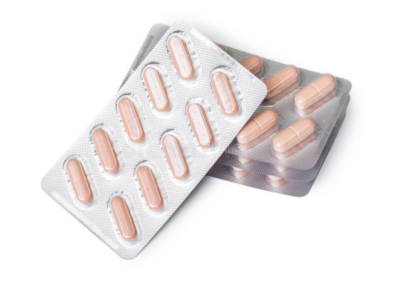 Píldoras en un grupo de paquetes de ampolla fotos de archivo libres de regalías