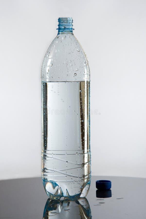 pół butelki wody. obrazy stock