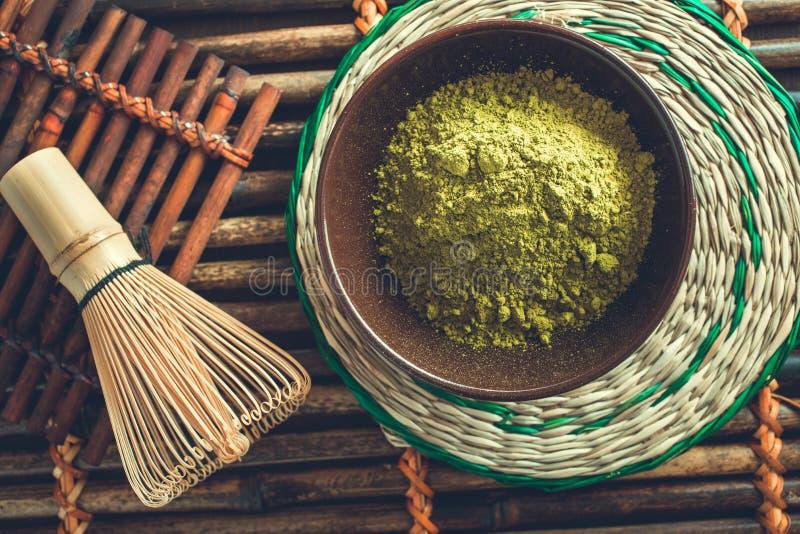 Pó verde orgânico do chá do matcha imagens de stock royalty free