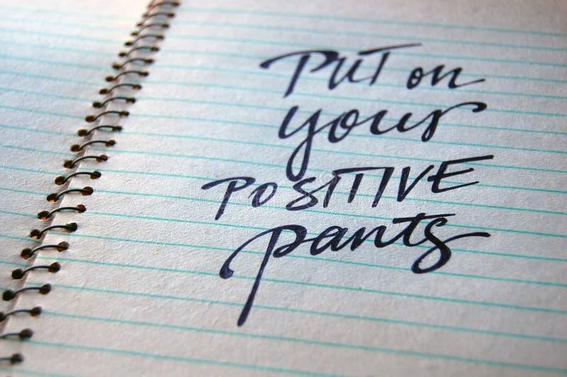 Põe sobre seu fundo caligráfico das calças positivas fotos de stock royalty free