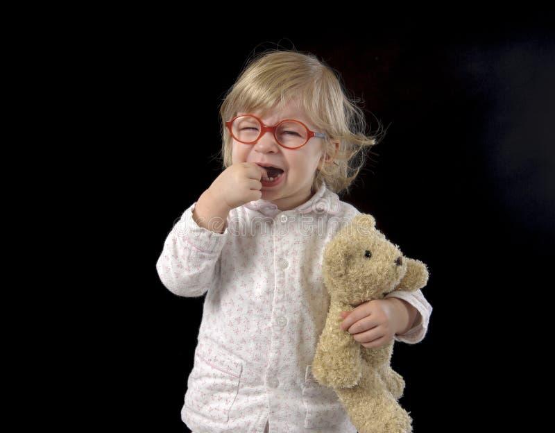 Płakać małego berbecia w piżamie zdjęcie royalty free