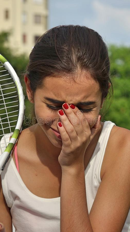 Płakać Nastoletniego Żeńskiego gracz w tenisa obraz stock