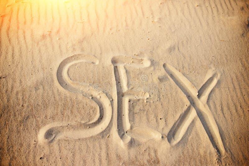 Płeć ręcznie pisany w piasku na plaży obrazy royalty free