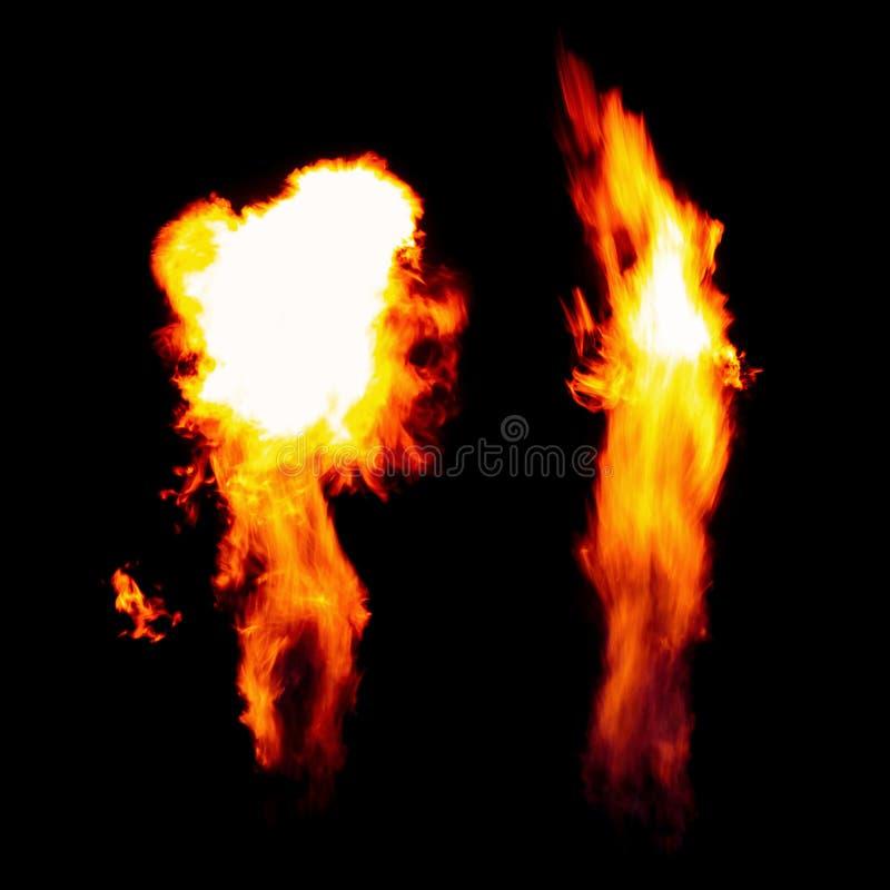 Płonąca pochodnia, płomienie w zmroku odizolowywającym na czarnym tle zdjęcie stock
