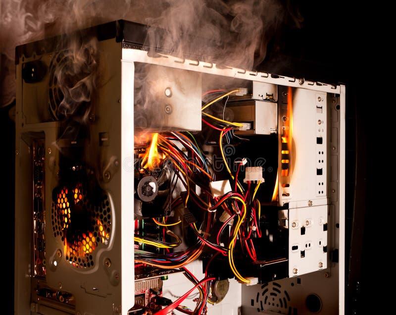 płonący komputer obraz stock