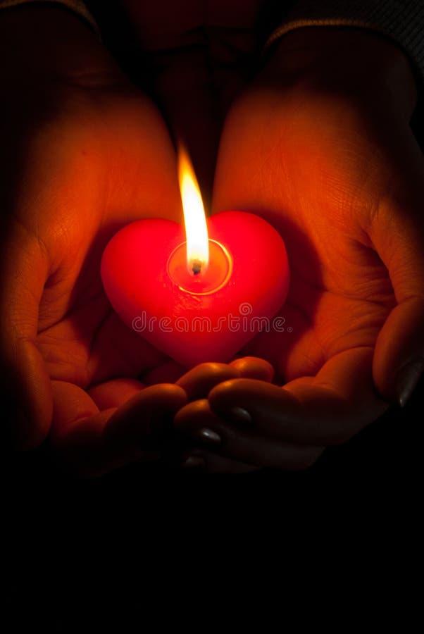 płonących świeczki ręk kierowa chwyta istota ludzka kształtująca zdjęcia royalty free