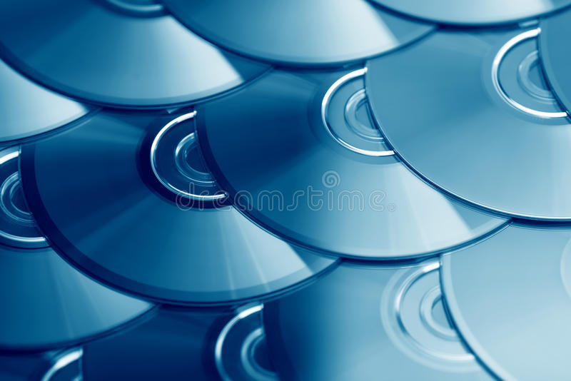 Płyty kompaktowa tło Kilka cd dvd Ray dyski Okulistyczny zdolny do nagrywania lub rewritable cyfrowy przechowywanie danych zdjęcia stock